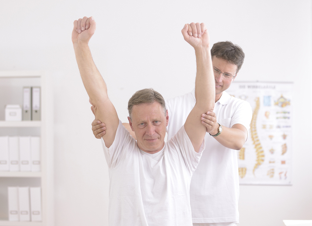 injured man gets chiropractic care